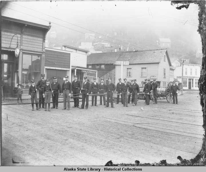 Juneau Fire Department on Front Street with hose cart, ca. 1890