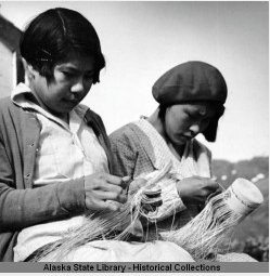 Young ladies weaving baskets on Attu.